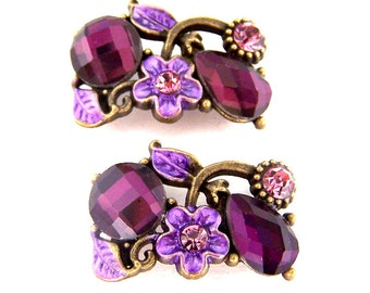 2 amethyst purple two hole beads, floral purple sliders, 2 hole buttons, spacers, amethyst crystals and enamel