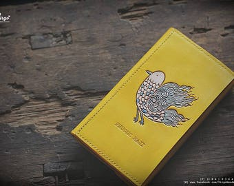 Yellow hand tooled/carved wallet with bird