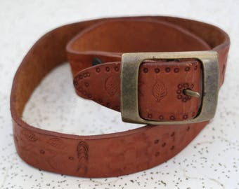 vintage tan leather hand stamped belt with brass buckle