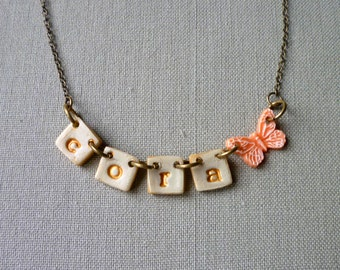 Butterfly and Name necklace on little tiles