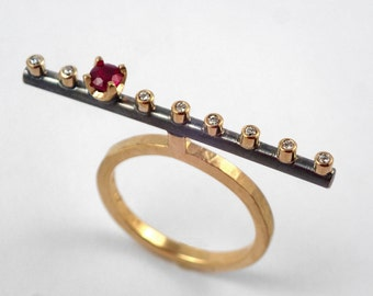 The flute. A 18K solid gold band statement ring with a genuine ruby and eight diamonds.