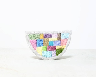 Embroidered Brooch. Modern Style. Hand Stitched Geometric Jewellery. Pastel Patchwork Motif. Colour Block Jewelry. Half Moon Shape.