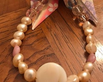 Fresh water pearls with pink accents
