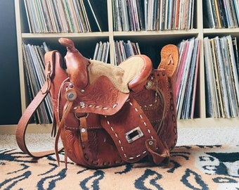 1970's side slung tooled leather saddle bag