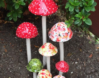 Eight hand crafted ceramic mushrooms, 1 extra large, 2 large, 1medium, 4 small, plant stakes, garden art, mushroom stake