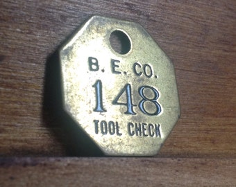 Vintage Brass B. E. Co. Tool Check Tag. Number 148.   Industrial Craft Supplies.