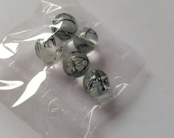 Set of 5 black and transparent glass beads. (8013012)