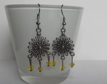 Swarovski yellow earrings.