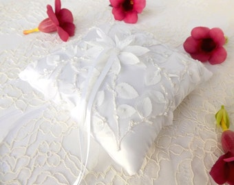 White wedding ring pillow decorated with chiffon flowers and leaves. Beaded lace flowers wedding ring bearer