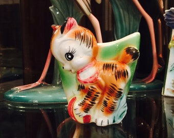 Anthropomorphic Orange Tabby Kitten with a Ball on a Green Planter made in Japan circa 1950s