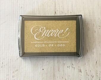 Tsukineko Encore Gold Metallic Stamp Pad for transluscent images in scrapbooking, cardmaking, stamping, art journaling, mixed media