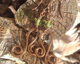 Rustic copper swirl earrings with green crystal bead