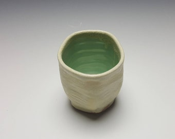 Ceramic tumbler by Potteryi.  Cream and celadon tumbler with 5 sides.