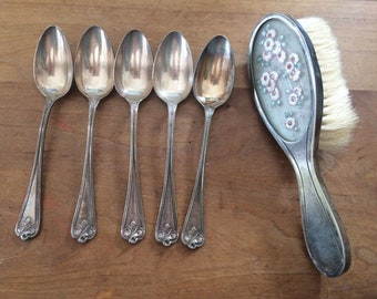 Vintage silvered spoons with brush