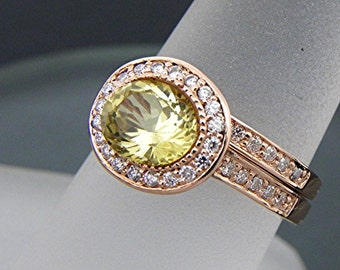 AAA Yellow Beryl Heliodor   7.4x6.5mm  1.45 Carats   Oval 14K Rose gold Halo bridal set with .35cts of diamonds. 774
