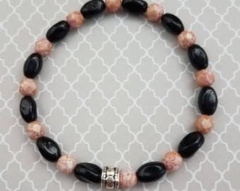 Handmade Pink Czech Faceted Beads with Oval Black Glass Beads on a Stretchy Bracelet