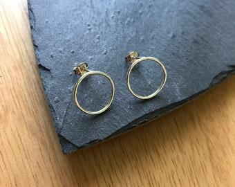 Hoop stud silver earrings.