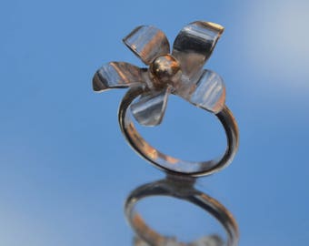 Sterling silver flower ring with 9 carat gold ball