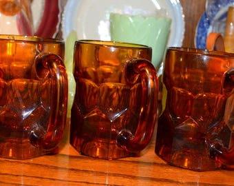 Set Of Three Amber Glass Mugs