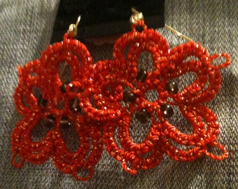 Sparkly orange tatted flower earrings