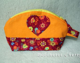 Rounded clutch orange and Red multicolored flowers with heart shaped pocket.
