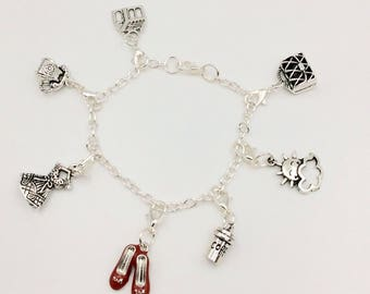 JW Pioneer Charm Bracelet.  Silver Plated Chain Bracelet with 7 Pioneer Charms.