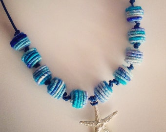 Blue necklace with textile beads and silver plated starfish pendant. OOAK