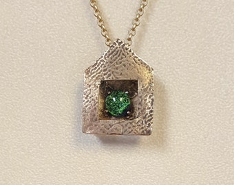 Bronze house with green dichroic glass cabochon