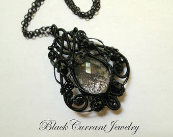 Tourmaline (Rutilated) Quartz and Black Victorian Style Wire Wrapped Pendant