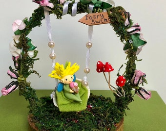 Cake decoration / Woodland faery on a shell swing
