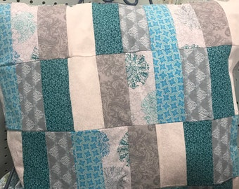 Pretty patchwork quilted pillow
