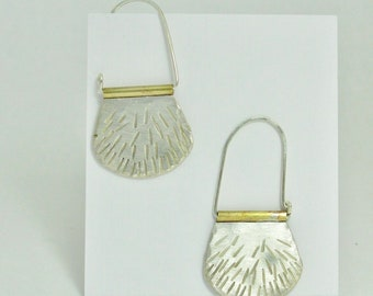 Hammered sterling silver hoop earrings, brass detail