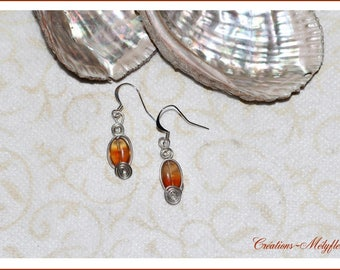 Earrings with spiral and orange stones
