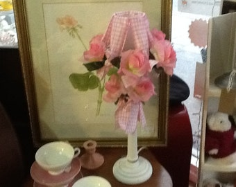 Hand made bedside lamp decorated with gingham ribbon and pink roses.