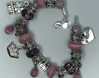 Princess themed charm bracelet in pink and black