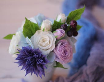 Clay flowers bouquet in a cup