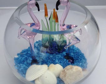 Flamingos in a glass bowl