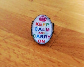 Sale: Antique brass 'Keep calm and carry on' filigree ring.