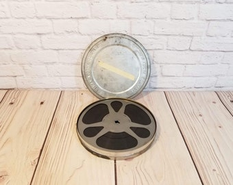 """Vintage 7"""" 8mm Film Reel in Canister Home Movie United Airlines"""