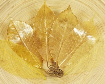Temple Leaves Collection -  Gold 539269  - Bendable pearlized lacquered  fabric leaves with dabs of glitter.