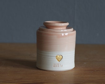 custom urn. gold infilled stamp with ceramic lid, straight shaped urn with heart stamp. modern simple urn for ashes. peach urn.