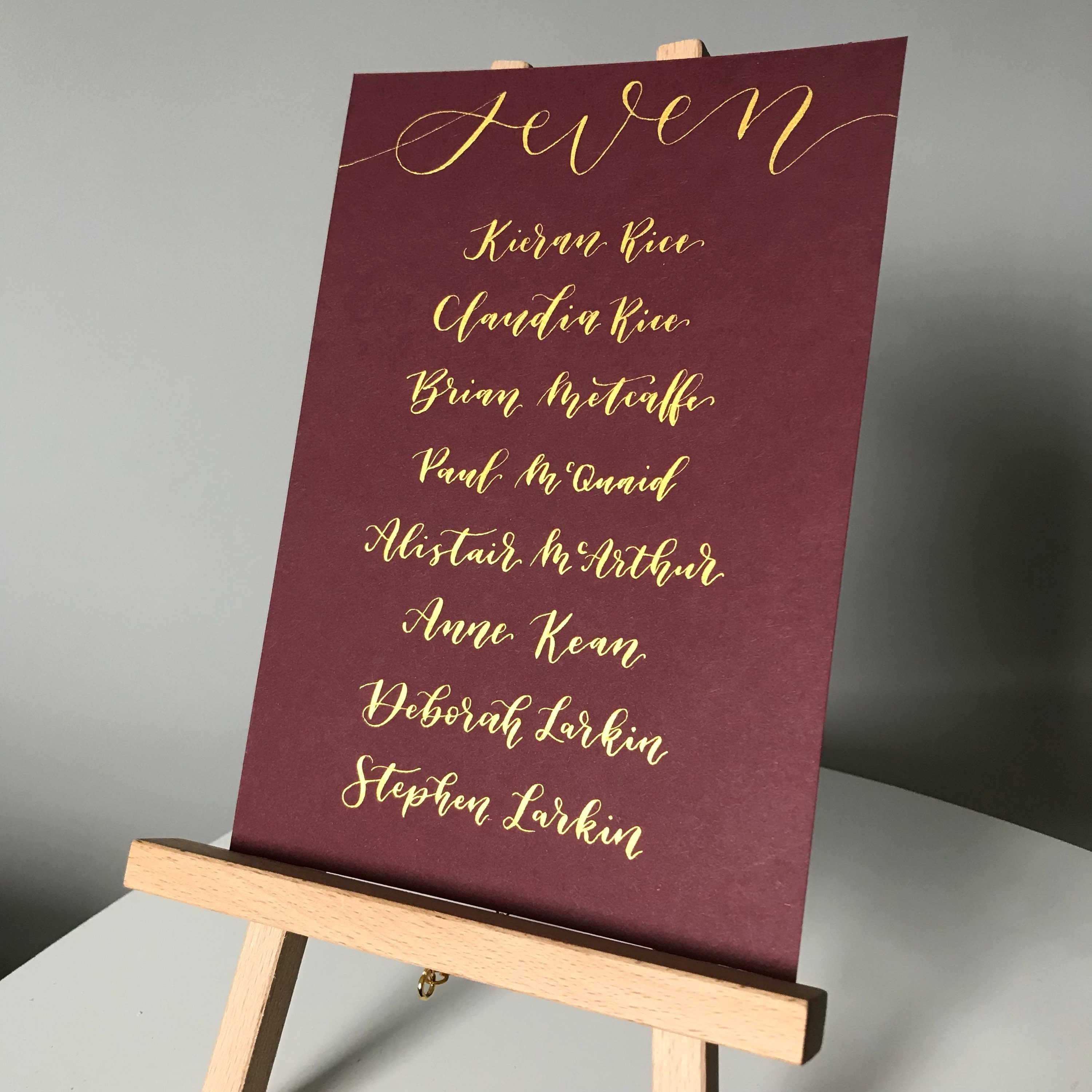 Hand lettered modern calligraphy style wedding table plan