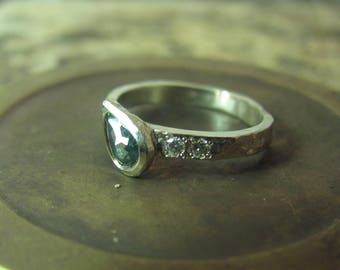 14K white gold ring set with Tourmaline and 2 small diamonds.Unusual & unique