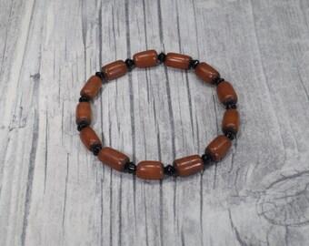 Palm seed bracelet brown black elastic
