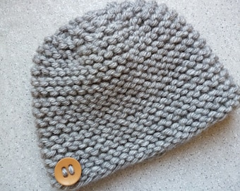 Wool cap for a head warm, knitted by hand