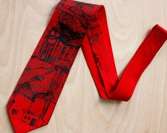 Hand Printed Silk Necktie in red silk with sage green and black architectural imagery, each is original and one of a kind