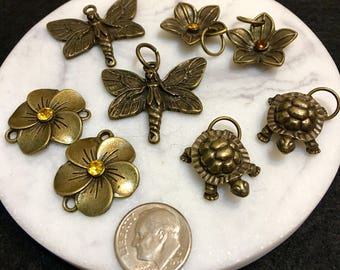 Assortment of antique brass charms and connectors, 4 pairs, fairy, turtle, flowers