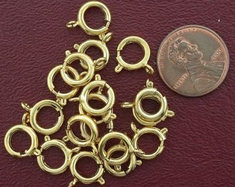 fifteen 9mm gold plated  spring rings
