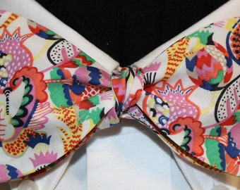 PARTY TIME Bow Tie: Liberty of London cotton, self tie, handmade in your size, for well-dressed men and women; Crazy pattern in pink, coral