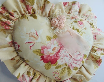 Heart pillow with pink flowers